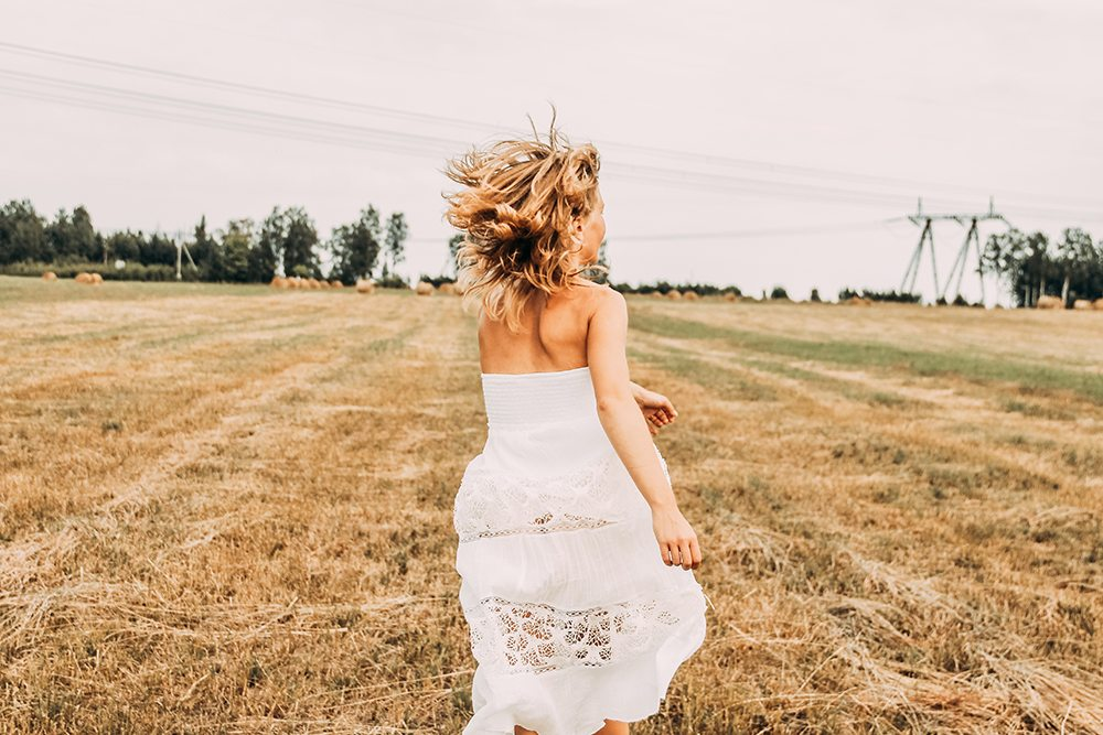 lady in white dress running